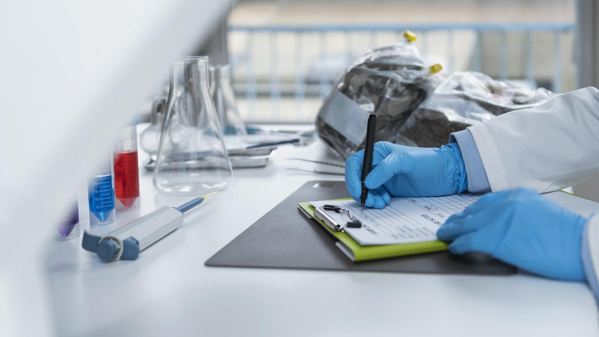 Organic Certification Laboratory. Filling a Form for Organic Certification Procedure